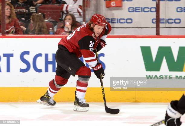 Ryan White of the Arizona Coyotes skates the puck up ice against the Pittsburgh Penguins at Gila River Arena on February 11 2017 in Glendale Arizona