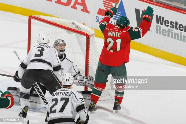 Ryan White of the Minnesota Wild celebrates after scoring a goal against Brayden McNabb and goalie Jonathan Quick of the Los Angeles Kings during the...