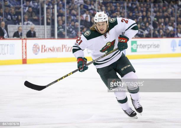 Ryan White of the Minnesota Wild follows the play down the ice during third period action against the Winnipeg Jets at the MTS Centre on February 28...