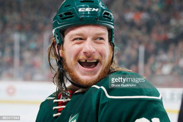 Ryan White of the Minnesota Wild laughs with his teammates during the game against the San Jose Sharks on March 5 2017 at the Xcel Energy Center in...