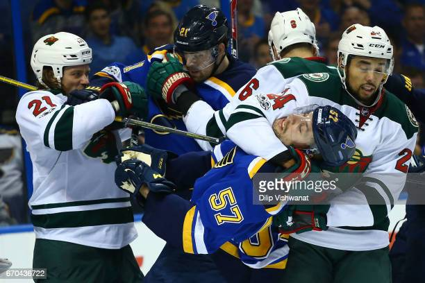 Ryan White of the Minnesota Wild tussles with Patrik Berglund of the St Louis Blues as Matt Dumba of the Minnesota Wild puts David Perron of the St...