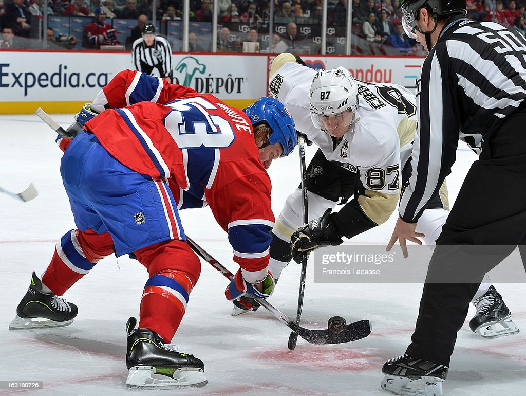 Ryan White #53 of the Montreal Canadiens and Sidney Crosby #87 of the Pittsburgh Penguins faces-off with during the NHL game on March 2, 2013 at the Bell Centre in Montreal, Quebec, Canada.