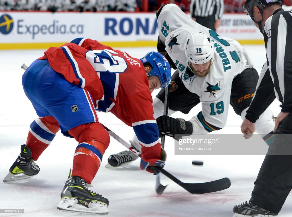 <a gi-track='captionPersonalityLinkClicked' href=/galleries/search?phrase=Ryan+White&family=editorial&specificpeople=225044 ng-click='$event.stopPropagation()'>Ryan White</a> #53 of the Montreal Canadiens faces off against <a gi-track='captionPersonalityLinkClicked' href=/galleries/search?phrase=Joe+Thornton&family=editorial&specificpeople=201829 ng-click='$event.stopPropagation()'>Joe Thornton</a> #19 of the San Jose Sharks during the NHL game on October 26, 2013 at the Bell Centre in Montreal, Quebec, Canada.