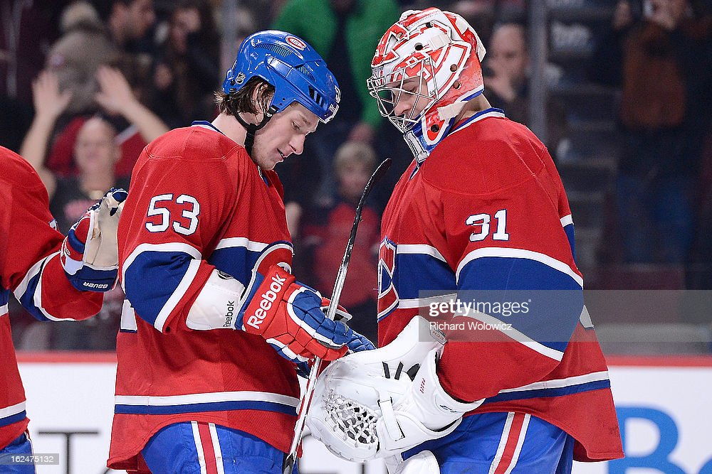 <a gi-track='captionPersonalityLinkClicked' href=/galleries/search?phrase=Ryan+White&family=editorial&specificpeople=225044 ng-click='$event.stopPropagation()'>Ryan White</a> #53 of the Montreal Canadiens gives the game puck to <a gi-track='captionPersonalityLinkClicked' href=/galleries/search?phrase=Carey+Price&family=editorial&specificpeople=2222083 ng-click='$event.stopPropagation()'>Carey Price</a> #31during the NHL game against the New York Rangers at the Bell Centre on February 23, 2013 in Montreal, Quebec, Canada. The Canadiens defeated the Rangers 3-0.