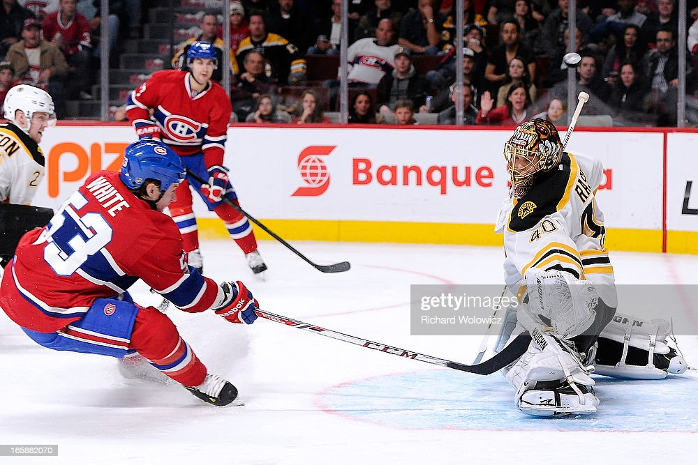 <a gi-track='captionPersonalityLinkClicked' href=/galleries/search?phrase=Ryan+White&family=editorial&specificpeople=225044 ng-click='$event.stopPropagation()'>Ryan White</a> #53 of the Montreal Canadiens shoots the puck over <a gi-track='captionPersonalityLinkClicked' href=/galleries/search?phrase=Tuukka+Rask&family=editorial&specificpeople=716723 ng-click='$event.stopPropagation()'>Tuukka Rask</a> #40 of the Boston Bruins during the NHL game at the Bell Centre on April 6, 2013 in Montreal, Quebec, Canada. The Canadiens defeated the Bruins 2-1.