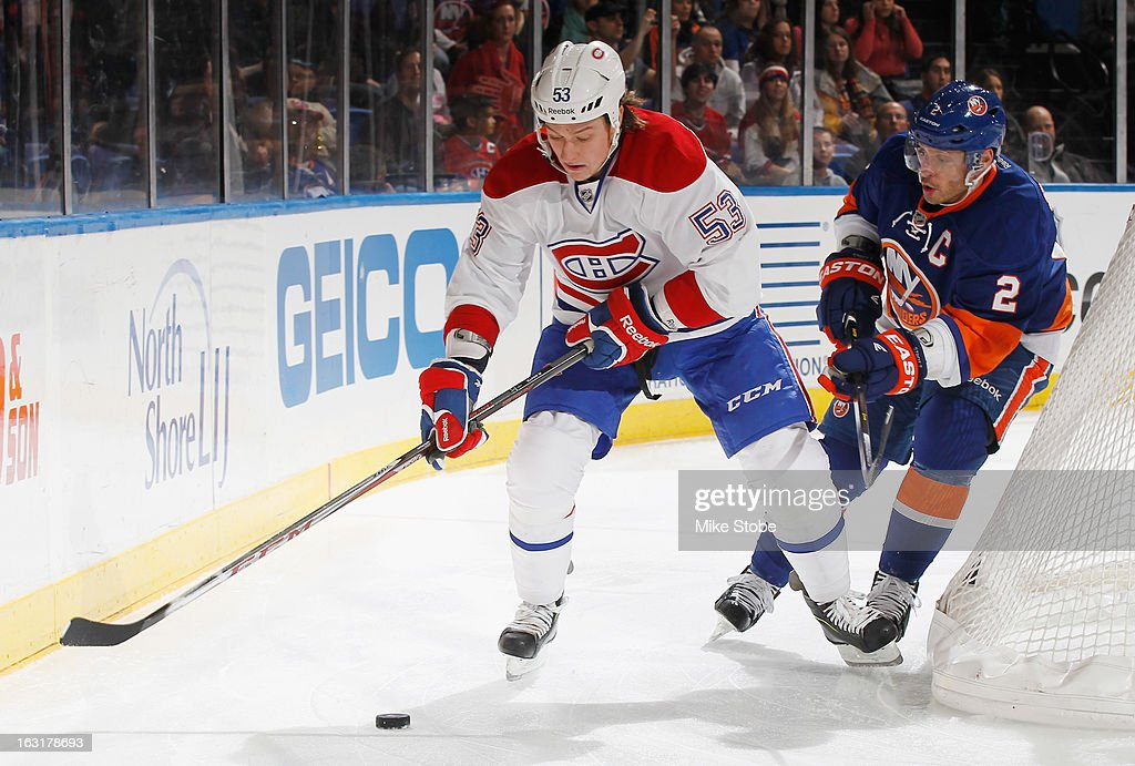 <a gi-track='captionPersonalityLinkClicked' href=/galleries/search?phrase=Ryan+White&family=editorial&specificpeople=225044 ng-click='$event.stopPropagation()'>Ryan White</a> #53 of the Montreal Canadiens skates with the puck as <a gi-track='captionPersonalityLinkClicked' href=/galleries/search?phrase=Mark+Streit&family=editorial&specificpeople=636976 ng-click='$event.stopPropagation()'>Mark Streit</a> #2 of the New York Islanders pursues him at Nassau Veterans Memorial Coliseum on March 5, 2013 in Uniondale, New York. The Islanders defeated the Canadiens 6-3.