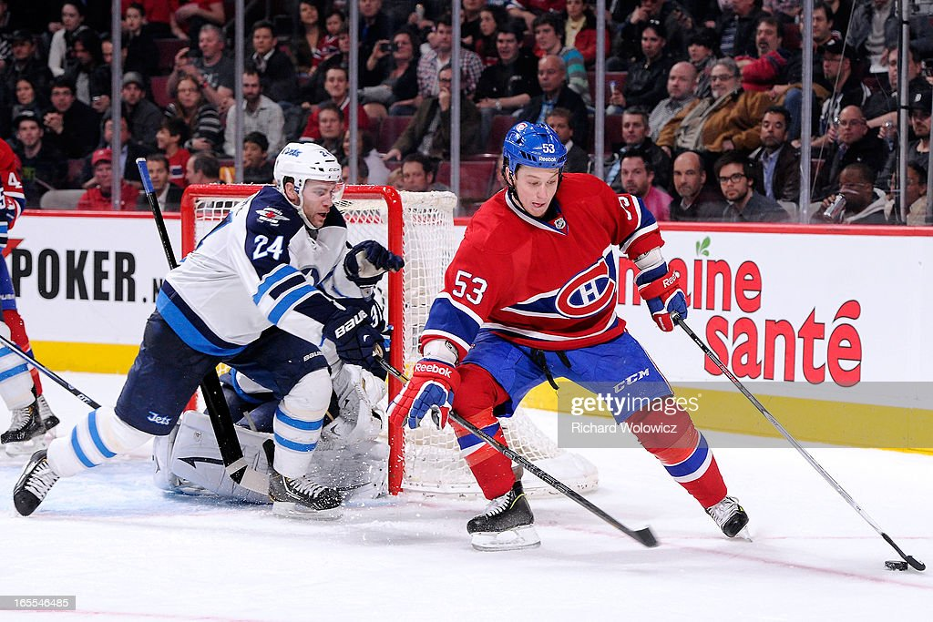 <a gi-track='captionPersonalityLinkClicked' href=/galleries/search?phrase=Ryan+White&family=editorial&specificpeople=225044 ng-click='$event.stopPropagation()'>Ryan White</a> #53 of the Montreal Canadiens stick handles the puck in front of Ondrej Pavelec #31 and Grant Clitsome #24 of the Winnipeg Jets during the NHL game at the Bell Centre on April 4, 2013 in Montreal, Quebec, Canada.