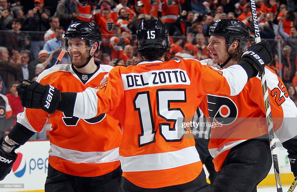 <a gi-track='captionPersonalityLinkClicked' href=/galleries/search?phrase=Ryan+White&family=editorial&specificpeople=225044 ng-click='$event.stopPropagation()'>Ryan White</a> #25 of the Philadelphia Flyers celebrates his second period goal against the New York Islanders with <a gi-track='captionPersonalityLinkClicked' href=/galleries/search?phrase=Andrew+MacDonald+-+Joueur+de+hockey+sur+glace&family=editorial&specificpeople=10579091 ng-click='$event.stopPropagation()'>Andrew MacDonald</a> #47 and <a gi-track='captionPersonalityLinkClicked' href=/galleries/search?phrase=Michael+Del+Zotto&family=editorial&specificpeople=4044191 ng-click='$event.stopPropagation()'>Michael Del Zotto</a> #15 on December 8, 2015 at the Wells Fargo Center in Philadelphia, Pennsylvania.