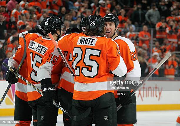 Ryan White of the Philadelphia Flyers celebrates his second period goal against the New York Islanders with Andrew MacDonald RJ Umberger and Michael...