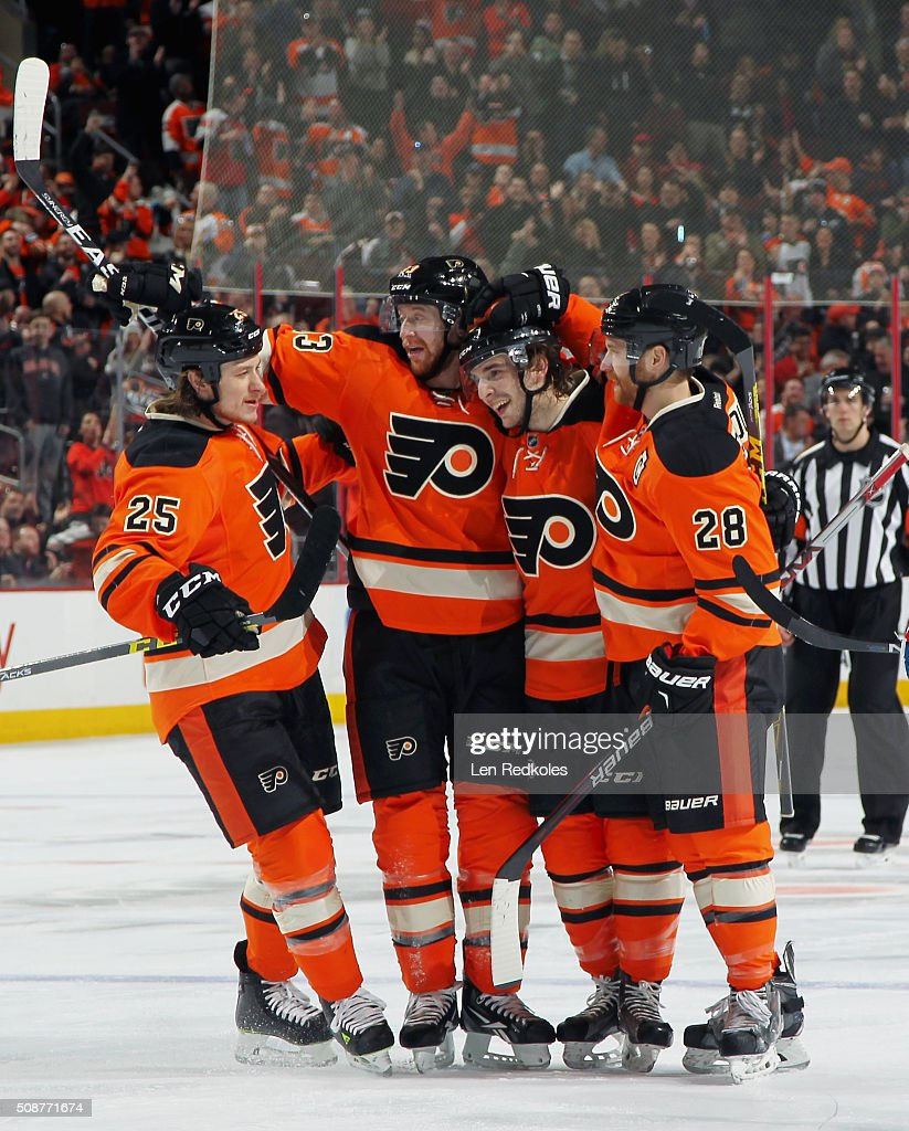 <a gi-track='captionPersonalityLinkClicked' href=/galleries/search?phrase=Ryan+White&family=editorial&specificpeople=225044 ng-click='$event.stopPropagation()'>Ryan White</a> #25 of the Philadelphia Flyers celebrates his second period power-play goal against the New York Rangers with teammates <a gi-track='captionPersonalityLinkClicked' href=/galleries/search?phrase=Jakub+Voracek&family=editorial&specificpeople=4111797 ng-click='$event.stopPropagation()'>Jakub Voracek</a> #93, Shayne Gostisbehere #53, and <a gi-track='captionPersonalityLinkClicked' href=/galleries/search?phrase=Claude+Giroux&family=editorial&specificpeople=537961 ng-click='$event.stopPropagation()'>Claude Giroux</a> #28 on February 6, 2016 at the Wells Fargo Center in Philadelphia, Pennsylvania.