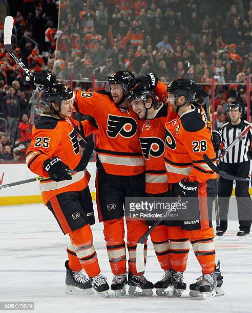 Ryan White of the Philadelphia Flyers celebrates his second period powerplay goal against the New York Rangers with teammates Jakub Voracek Shayne...