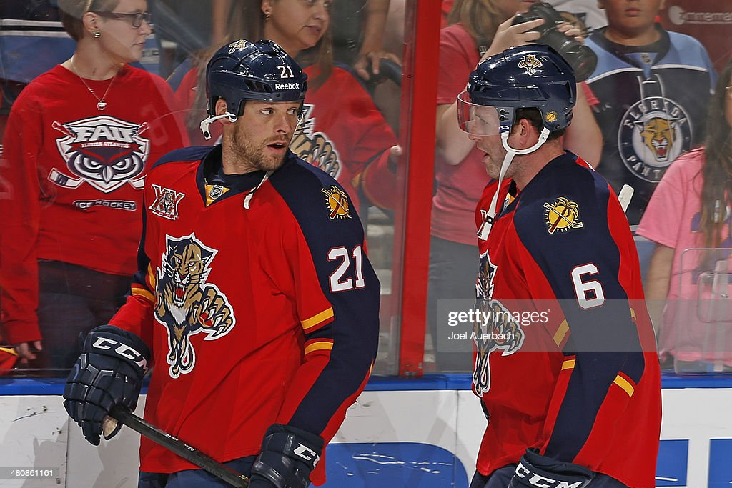 Ryan Whitney and Krys Barch of the Florida Panthers talk during the warm up prior to the game against the Ottawa Senators at the BBT Center on March...