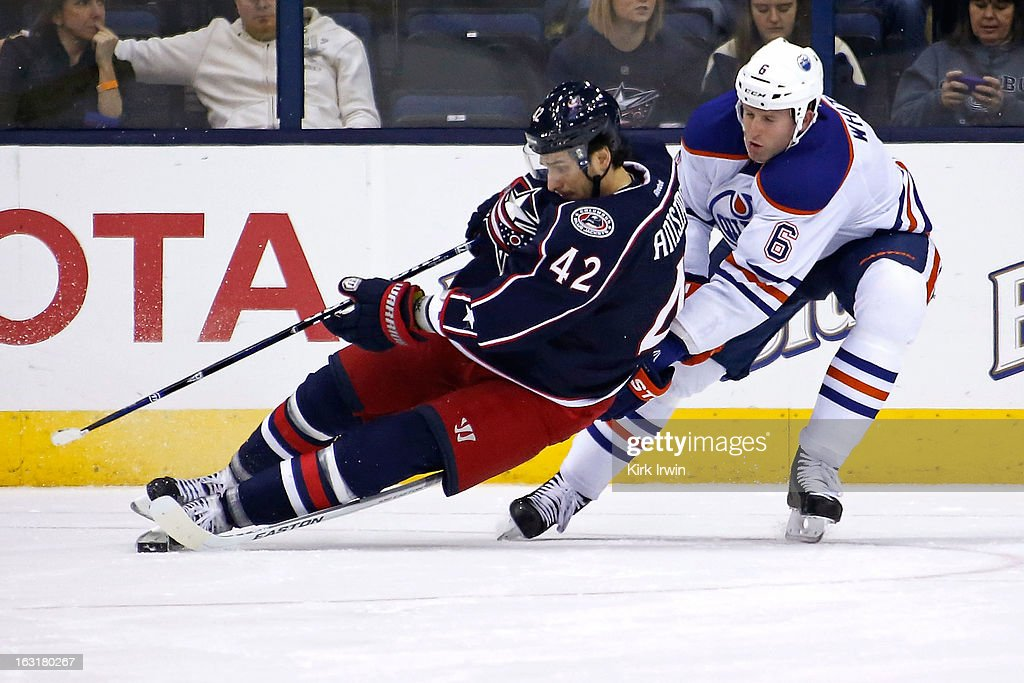 <a gi-track='captionPersonalityLinkClicked' href=/galleries/search?phrase=Ryan+Whitney&family=editorial&specificpeople=584338 ng-click='$event.stopPropagation()'>Ryan Whitney</a> #6 of the Edmonton Oilers trips Artem Ansimov #42 of the Columbus Blue Jackets during the first period on March 5, 2013 at Nationwide Arena in Columbus, Ohio. Columbus defeated Edmonton 4-3 in a shootout.
