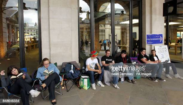 Ryan Williams from Swanley and Peter King from Tunbridge queue first and second in line to raise money for Cancer Research outside the Apple store in...