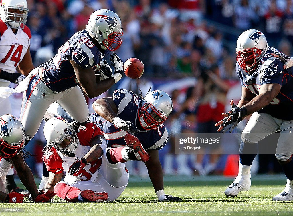 Ryan Williams #34 of the Arizona Cardinals fumbles as <a gi-track='captionPersonalityLinkClicked' href=/galleries/search?phrase=Chandler+Jones&family=editorial&specificpeople=7181843 ng-click='$event.stopPropagation()'>Chandler Jones</a> #95, Kyle Love #74, and <a gi-track='captionPersonalityLinkClicked' href=/galleries/search?phrase=Vince+Wilfork&family=editorial&specificpeople=226996 ng-click='$event.stopPropagation()'>Vince Wilfork</a> #75 of the New England Patriots chase the ball at Gillette Stadium on September 16, 2012 in Foxboro, Massachusetts.