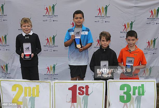 Ryan Willy second place winner Max Shepardson first place winner and in a tie for third Noah Jordi and Gavin Richardson in the Boys 79 Putting...