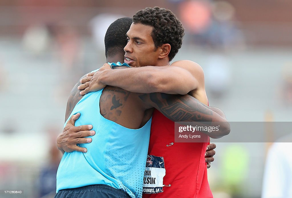 Ryan Wilson (right) hugs David Oliver after Wilson won the Men's 110 Meter Hurdles Meter on day four of the 2013 USA Outdoor Track & Field Championships at Drake Stadium on June 23, 2013 in Des Moines, Iowa.