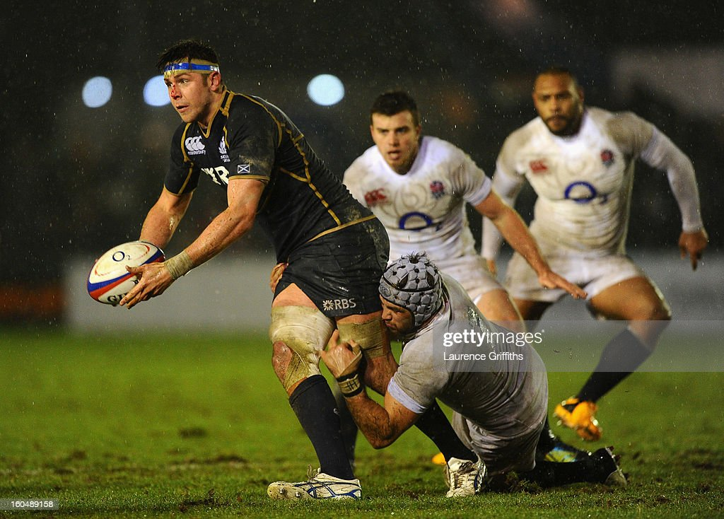 Ryan Wilson of Scotland is tackled by Will Fraser of England Saxons during the International Friendly match between England Saxons and Scotland A at Kingston Park on February 1, 2013 in Newcastle upon Tyne, England.