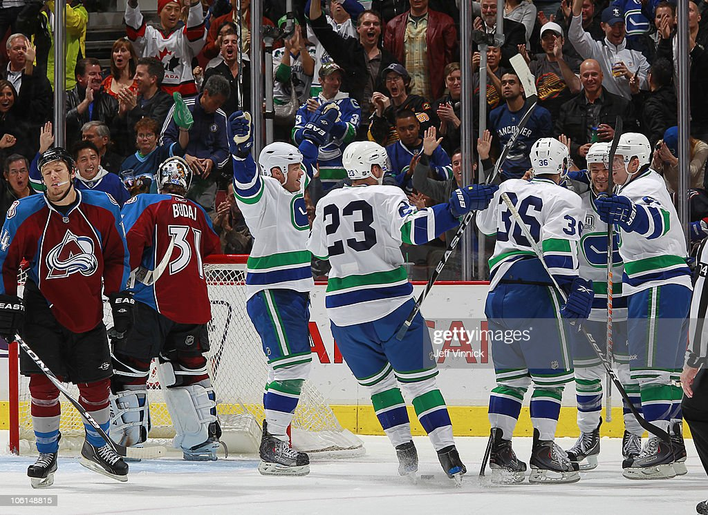 Ryan Wilson #44 of the Colorado Avalanche looks on dejected as Peter Schaefer #18 of the Vancouver Canucks is congratulated by teammates after scoring on Peter Budaj #31 of the Colorado Avalanche at Rogers Arena on October 26, 2010 in Vancouver, British Columbia, Canada. Vancouver won 4-3 in overtime.