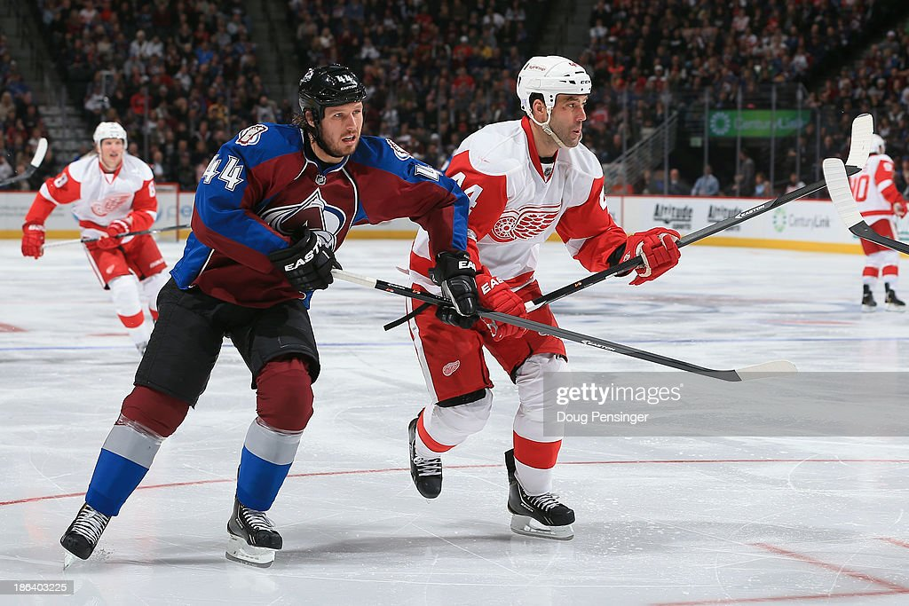 Ryan Wilson #44 of the Colorado Avalanche skates against <a gi-track='captionPersonalityLinkClicked' href=/galleries/search?phrase=Todd+Bertuzzi&family=editorial&specificpeople=202476 ng-click='$event.stopPropagation()'>Todd Bertuzzi</a> #44 of the Detroit Red Wings at Pepsi Center on October 17, 2013 in Denver, Colorado.