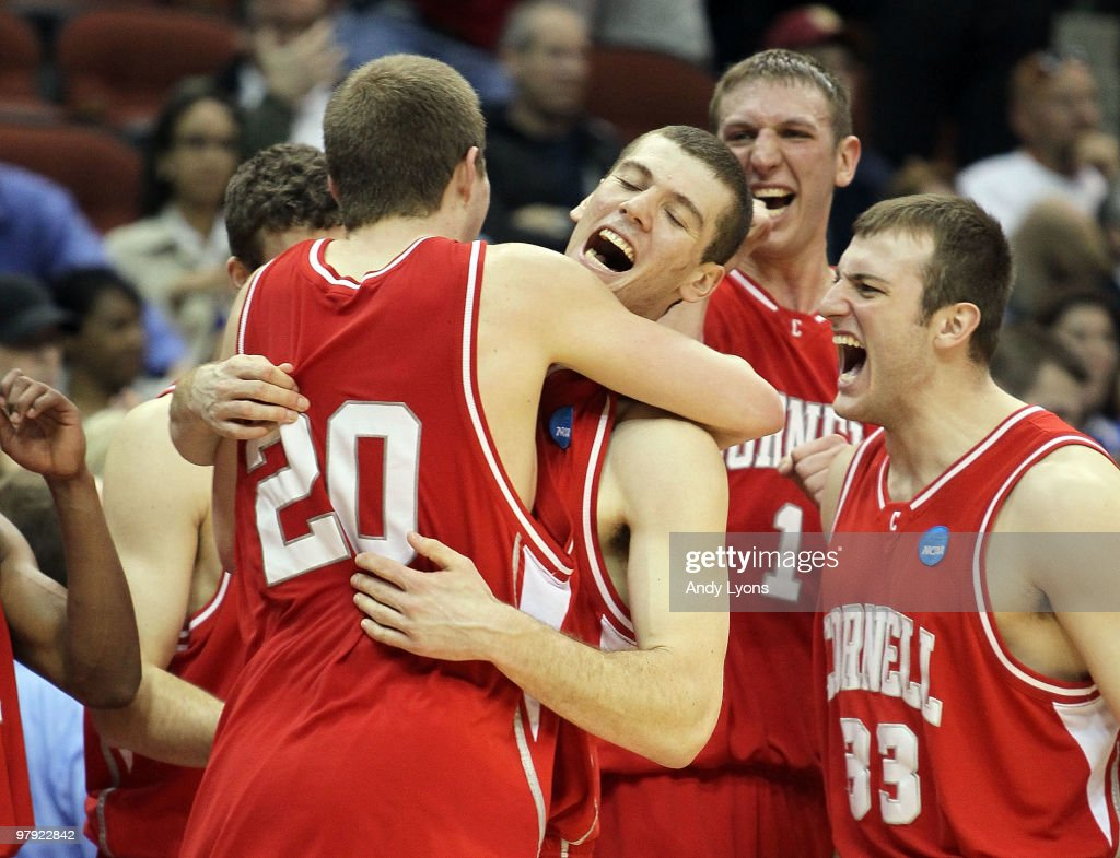 Ryan Wittman Jon Jaques Jeff Foote and Alex Taylor of the Cornell Big Red celebrate after defeating the Wisconsin Badgers during the second round of...