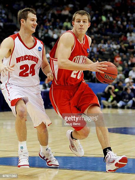 Ryan Wittman of the Cornell Big Red drives past Tim Jarmusz of the Wisconsin Badgers during the second round of the 2010 NCAA men's basketball...