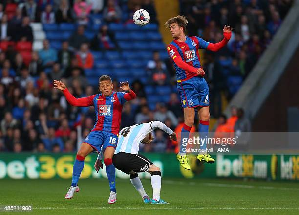Ryan Woods of Shrewsbury Town is crowded out by Dwight Gayle and Patrick Bamford of Crystal Palace during the Capital One Cup match between Crystal...