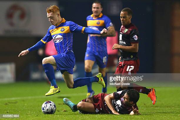 Ryan Woods of Shrewsbury Town leaps ove the challenge from Javier Garrido of Norwich City during the Capital One Cup Third Round match between...