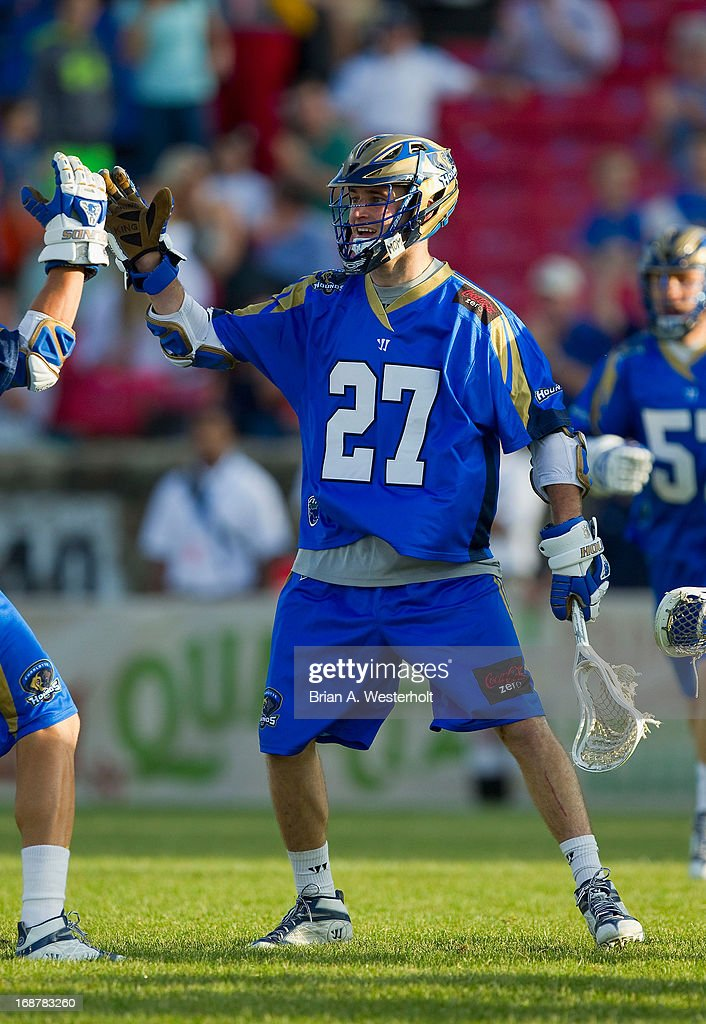 Ryan Young #27 of the Charlotte Hounds celebrates after scoring a goal against the Rochester Rattlers at American Legion Memorial Stadium on May 11, 2013 in Charlotte, North Carolina. The Rattlers defeated the Hounds 13-10.