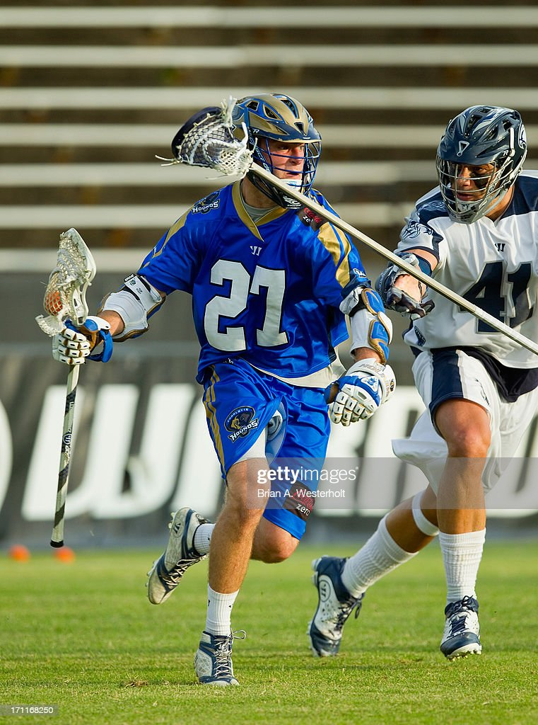 Ryan Young #27 of the Charlotte Hounds is checked by Nicky Polanco #41 of the Chesapeake Bayhawks at American Legion Memorial Stadium on June 22, 2013 in Charlotte, North Carolina. The Hounds defeated the Bayhawks 16-15 in overtime.