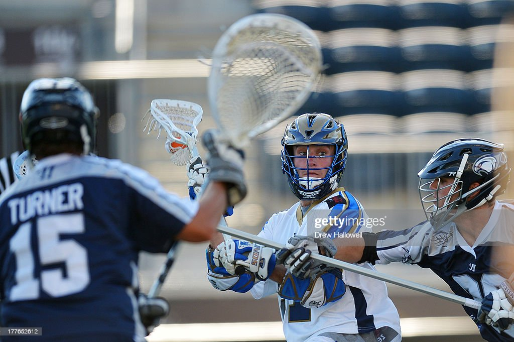 Ryan Young #27 of the Charlotte Hounds looks to pass against the Chesapeake Bayhawks during the MLL Championship at PPL Park on August 25, 2013 in Chester, Pennsylvania. Chesapeake won 10-9.