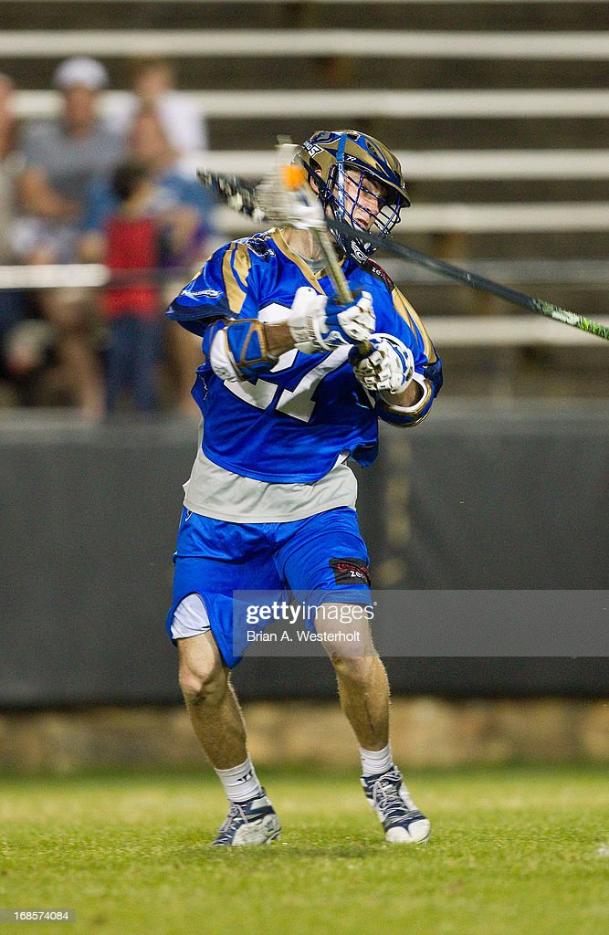 Ryan Young #27 of the Charlotte Hounds scores his fifth goal of the game against the Rochester Rattlers at American Legion Memorial Stadium on May 11, 2013 in Charlotte, North Carolina. The Rattlers defeated the Hounds 13-10.