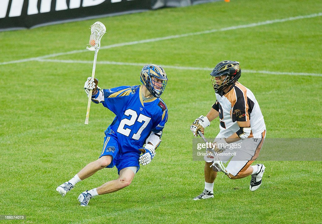 Ryan Young #27 of the Charlotte Hounds tries to run past Dan Groot #2 of the Rochester Rattlers during second half action at American Legion Memorial Stadium on May 11, 2013 in Charlotte, North Carolina. The Rattlers defeated the Hounds 13-10.