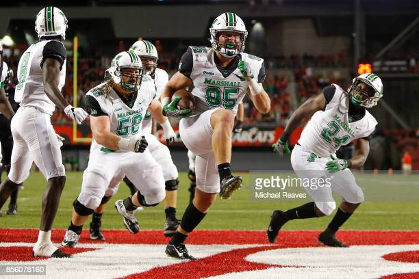 Ryan Yurachek of the Marshall Thundering Herd celebrates after scoring a touchdown against the Cincinnati Bearcats during the first half at Nippert...