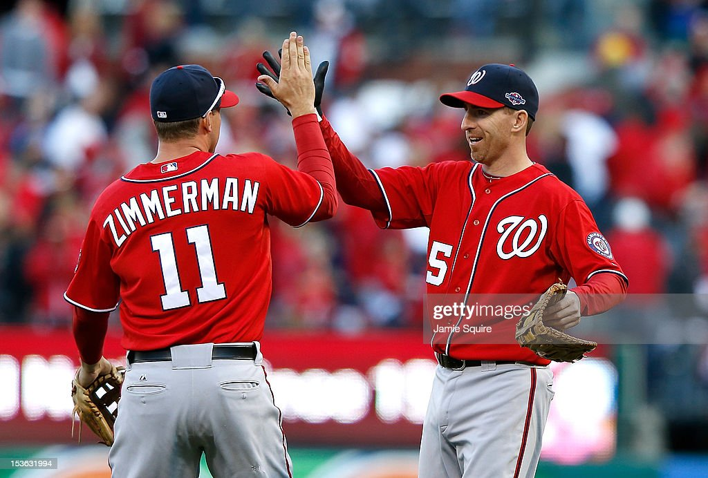 <a gi-track='captionPersonalityLinkClicked' href=/galleries/search?phrase=Ryan+Zimmerman+-+Baseball+Player&family=editorial&specificpeople=534809 ng-click='$event.stopPropagation()'>Ryan Zimmerman</a> #11 and <a gi-track='captionPersonalityLinkClicked' href=/galleries/search?phrase=Adam+LaRoche&family=editorial&specificpeople=216533 ng-click='$event.stopPropagation()'>Adam LaRoche</a> #25 of the Washington Nationals celebrate after defeating the St Louis Cardinals during Game One of the National League Division Series at Busch Stadium on October 7, 2012 in St Louis, Missouri.
