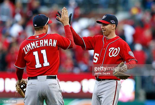 Ryan Zimmerman and Adam LaRoche of the Washington Nationals celebrate after defeating the St Louis Cardinals during Game One of the National League...