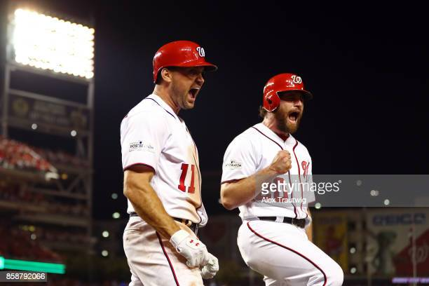Ryan Zimmerman celebrates with Daniel Murphy of the Washington Nationals after hitting a threerun home run in the eighth inning during Game 2 of the...