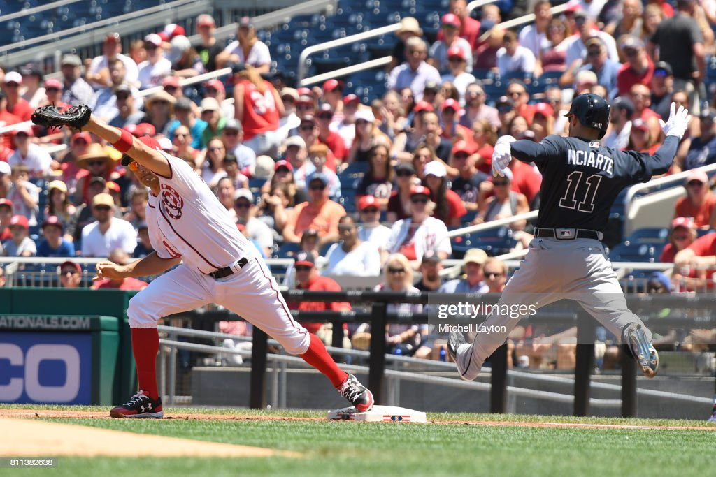 Ryan Zimmerman #11 of the Washington Nationals catches the ball to beat Ender Inciarte #11 of the Atlanta Braves at first during a baseball game at Nationals Park on July 9, 2017 in Washington, DC.
