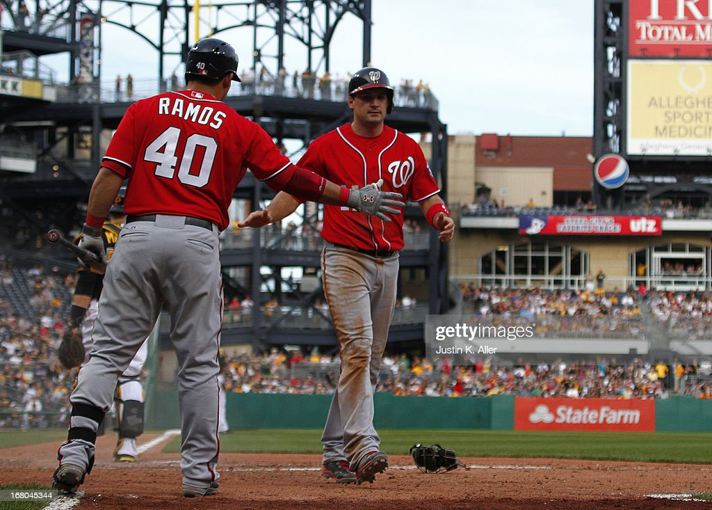 <a gi-track='captionPersonalityLinkClicked' href=/galleries/search?phrase=Ryan+Zimmerman+-+Baseball+Player&family=editorial&specificpeople=534809 ng-click='$event.stopPropagation()'>Ryan Zimmerman</a> #11 of the Washington Nationals celebrates after scoring on sacrifice fly in the ninth inning against the Pittsburgh Pirates during the game on May 4, 2013 at PNC Park in Pittsburgh, Pennsylvania.