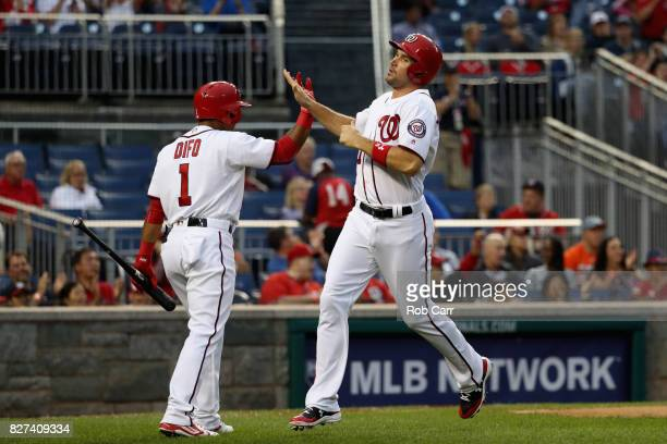 Ryan Zimmerman of the Washington Nationals celebrates after scoring with Wilmer Difo in the second inning against the Miami Marlins at Nationals Park...