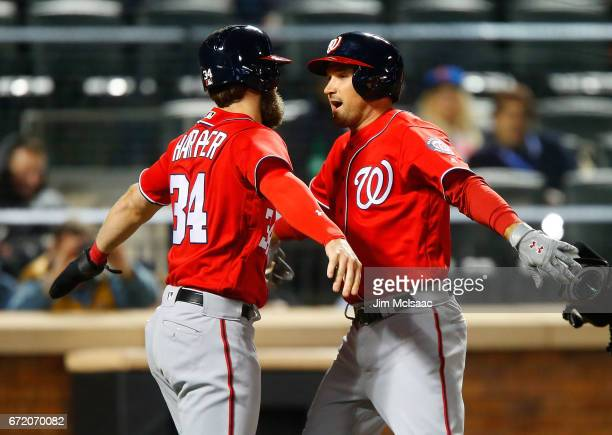 Ryan Zimmerman of the Washington Nationals celebrates his eighth inning two run home run against the New York Mets with teammate Bryce Harper at Citi...