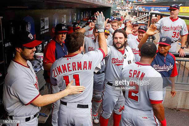 Ryan Zimmerman of the Washington Nationals celebrates his first inning home run against the New York Mets with teammate Tanner Roark at Citi Field on...