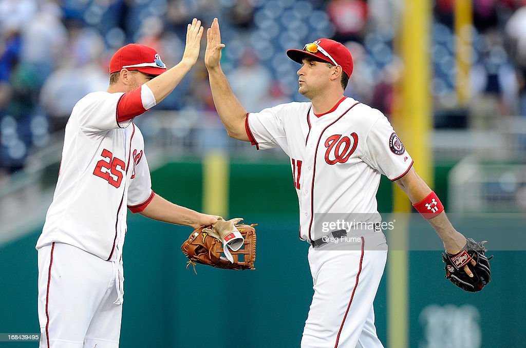 <a gi-track='captionPersonalityLinkClicked' href=/galleries/search?phrase=Ryan+Zimmerman+-+Baseball+Player&family=editorial&specificpeople=534809 ng-click='$event.stopPropagation()'>Ryan Zimmerman</a> #11 of the Washington Nationals celebrates with <a gi-track='captionPersonalityLinkClicked' href=/galleries/search?phrase=Adam+LaRoche&family=editorial&specificpeople=216533 ng-click='$event.stopPropagation()'>Adam LaRoche</a> #25 after a 5-4 victory against the Detroit Tigers at Nationals Park on May 9, 2013 in Washington, DC.