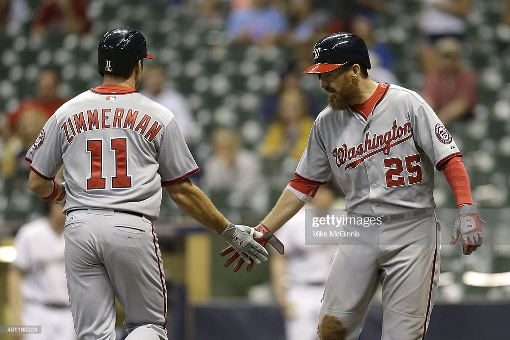 Ryan Zimmerman #11 of the Washington Nationals celebrates with Adam LaRoche #25 after hitting a two run homer in the top of the sixteenth inning against the Milwaukee Brewers at Miller Park on June 24, 2014 in Milwaukee, Wisconsin.