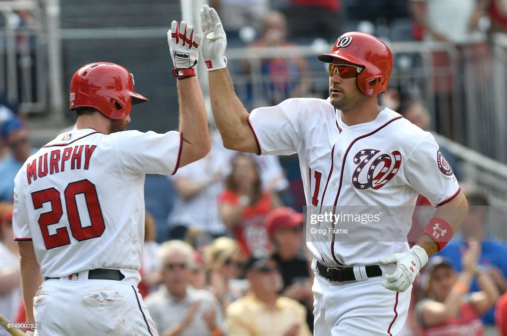 Ryan Zimmerman #11 of the Washington Nationals celebrates with Daniel Murphy #20 after a home run in the eighth inning against the New York Mets at Nationals Park on April 29, 2017 in Washington, DC. New York won the game 5-3.