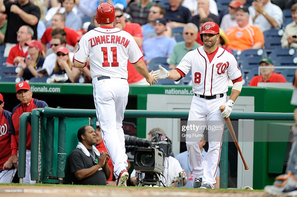 <a gi-track='captionPersonalityLinkClicked' href=/galleries/search?phrase=Ryan+Zimmerman+-+Baseball+Player&family=editorial&specificpeople=534809 ng-click='$event.stopPropagation()'>Ryan Zimmerman</a> #11 of the Washington Nationals celebrates with <a gi-track='captionPersonalityLinkClicked' href=/galleries/search?phrase=Danny+Espinosa&family=editorial&specificpeople=4410764 ng-click='$event.stopPropagation()'>Danny Espinosa</a> #8 after scoring in the first inning against the Detroit Tigers at Nationals Park on May 9, 2013 in Washington, DC.