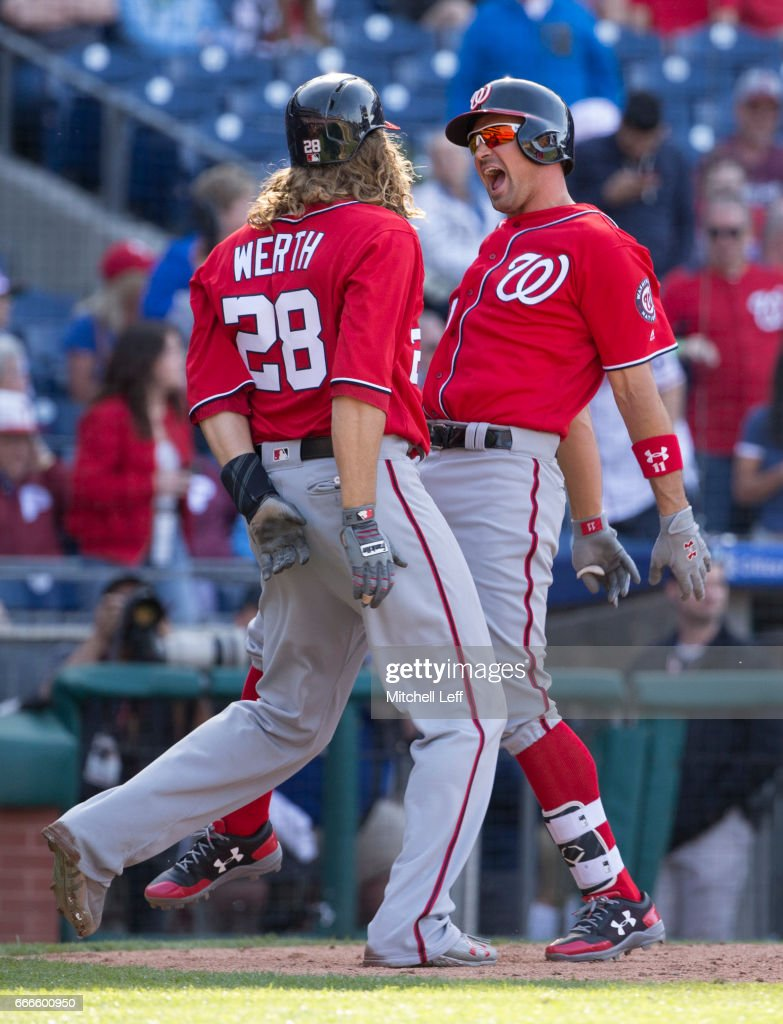 Ryan Zimmerman #11 of the Washington Nationals celebrates with Jayson Werth #28 after hitting a three run home run in the top of the ninth inning against the Philadelphia Phillies at Citizens Bank Park on April 9, 2017 in Philadelphia, Pennsylvania. The Phillies defeated the Nationals 4-3.