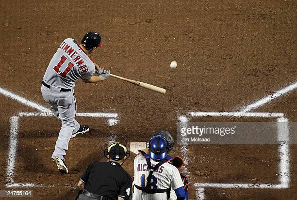 Ryan Zimmerman of the Washington Nationals connects on a first inning base hit against the New York Mets at Citi Field on September 12 2011 in the...