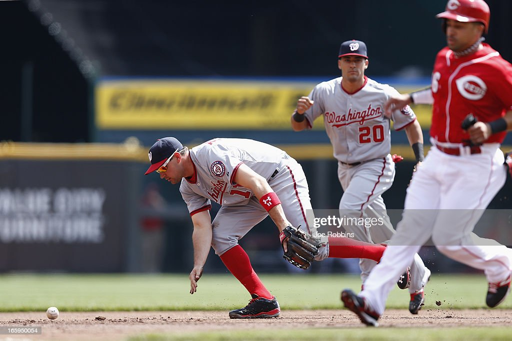 <a gi-track='captionPersonalityLinkClicked' href=/galleries/search?phrase=Ryan+Zimmerman+-+Baseball+Player&family=editorial&specificpeople=534809 ng-click='$event.stopPropagation()'>Ryan Zimmerman</a> #11 of the Washington Nationals drops the ball while fielding against the Cincinnati Reds during a game at Great American Ball Park on April 7, 2013 in Cincinnati, Ohio.