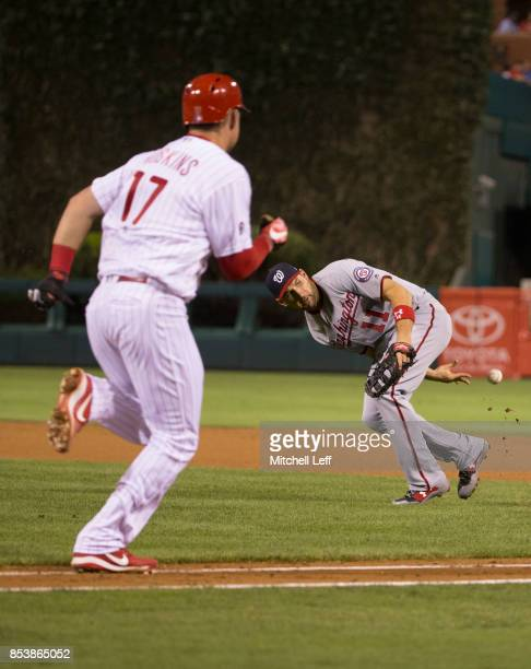 Ryan Zimmerman of the Washington Nationals flips the ball behind his back to throw out Rhys Hoskins of the Philadelphia Phillies in the bottom of the...